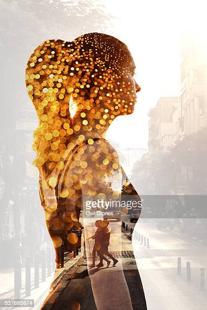 Multiple exposure of a young beautiful woman and city street