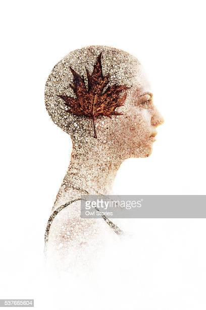 Multiple exposure of a young beautiful woman and dry autumn leaf on concrete surface