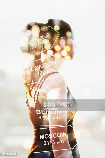 Multiple exposure of a young beautiful woman, traffic lights and direction signs with distance to large cities