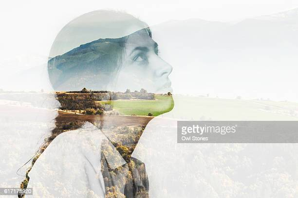 multiple exposure of a young woman and mountain landscape - mehrfachbelichtung stock-fotos und bilder