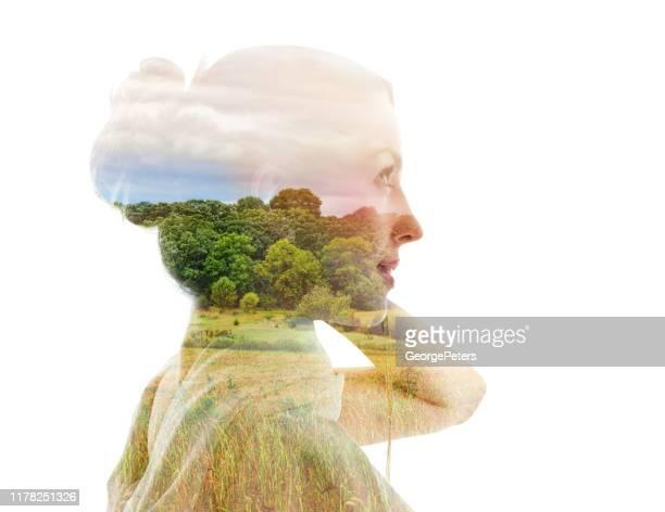 multiple exposure of a young woman and nature - esposizione multipla foto e immagini stock