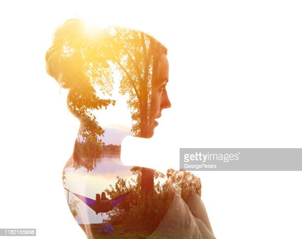 multiple exposure of a young woman and nature - mindfulness stock pictures, royalty-free photos & images