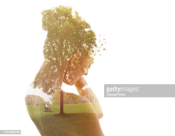 multiple exposure of a young woman and public park - self improvement stock pictures, royalty-free photos & images