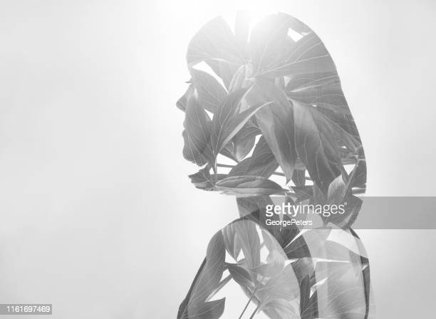 multiple exposure of a young woman morphing into leaves - high key stock pictures, royalty-free photos & images