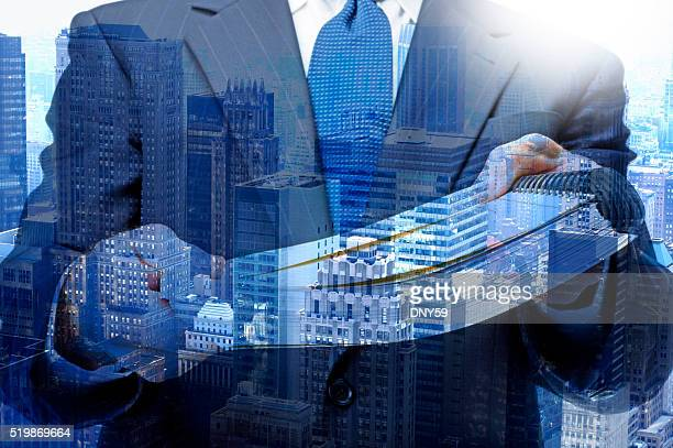 Multiple Exposure Of Businessman Handing Report To Viewer
