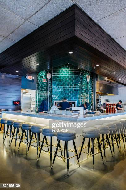 Multiple exposure of busy bartender at bar
