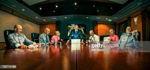 multiple exposure of caucasian businessmen in conference room - idiots stock pictures, royalty-free photos & images