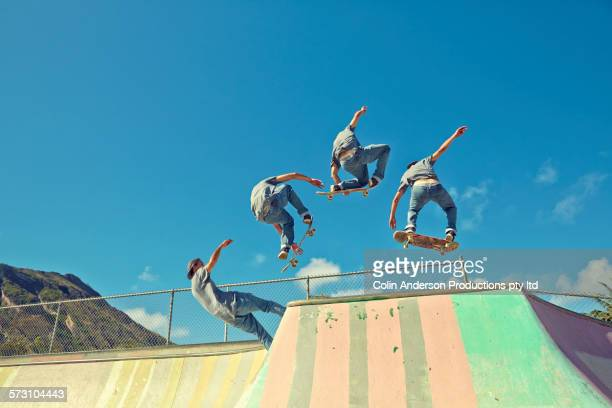 multiple exposure of caucasian man performing trick at skate park - multiple exposure sport stock pictures, royalty-free photos & images