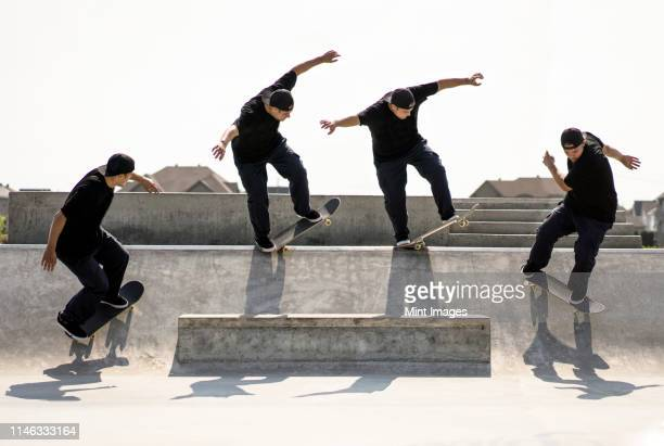multiple exposure of caucasian man riding skateboard in skate park - multiple exposure sport stock pictures, royalty-free photos & images