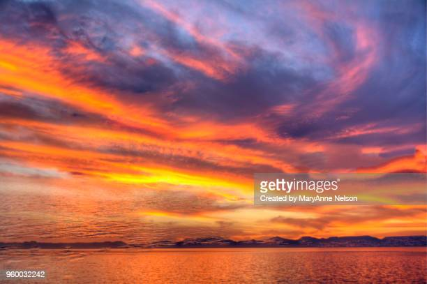multiple exposure of colorful sunset with clouds, land, water - sea of cortez stock pictures, royalty-free photos & images