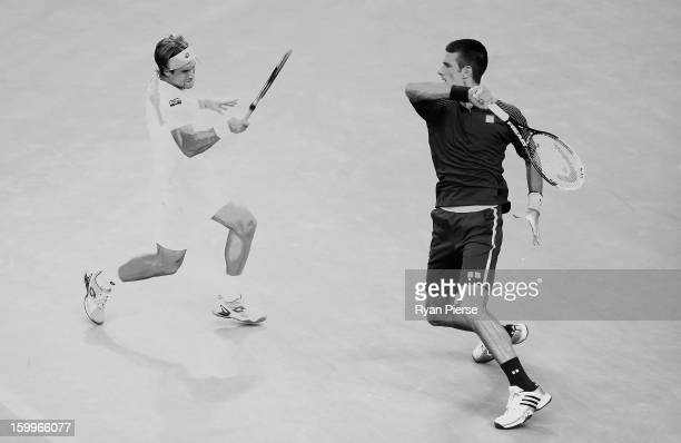 A multiple exposure of David Ferrer of Spain and Novak Djokovic of Serbia during their Semifinal match during day eleven of the 2013 Australian Open...
