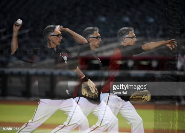 A multiple exposure of first base coach Dave McKay of the Arizona Diamondbacks throwing batting practice prior to a game against the Colorado Rockies...