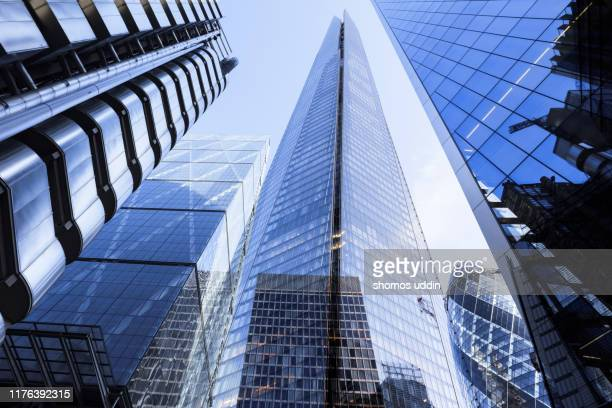 multiple exposure of futuristic london skyscrapers - finance stock pictures, royalty-free photos & images