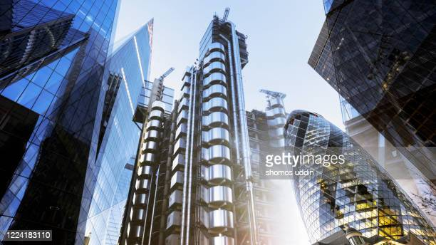 multiple exposure of futuristic skyscrapers in london city - tower stock pictures, royalty-free photos & images