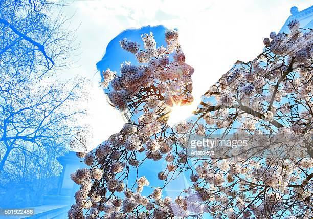 Multiple exposure of girl and tree blossoms