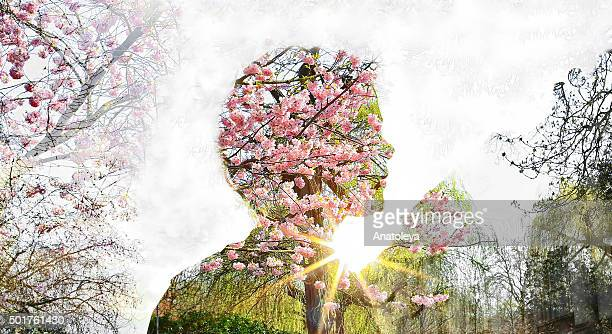 multiple exposure of girl, flowers and sunlight - anatoleya stock pictures, royalty-free photos & images