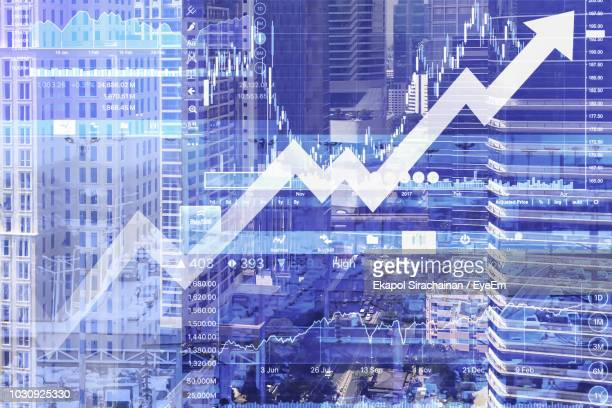 Multiple Exposure Of Graph And Modern Office Building In City