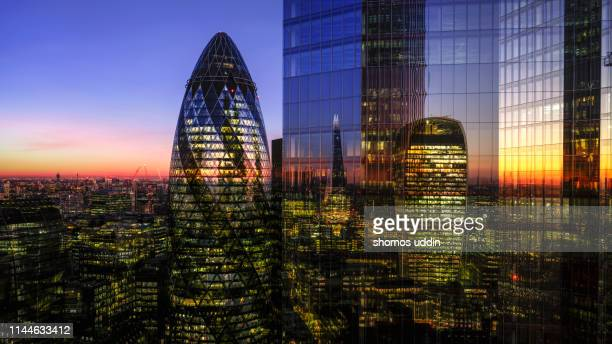 multiple exposure of high rise office buildings - wealth stock pictures, royalty-free photos & images