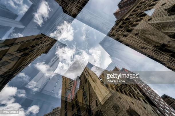 Multiple exposure of highrises under cloudy sky