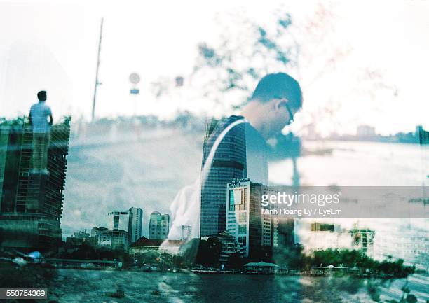 Multiple Exposure Of Men And River Against Sky