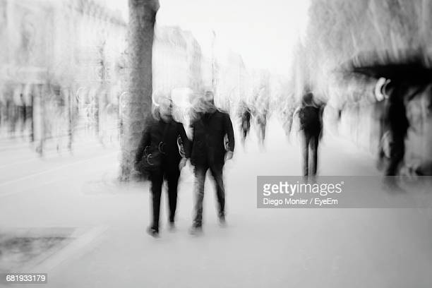 Multiple Exposure Of Men In City