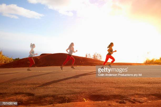 multiple exposure of mixed race woman running in middle of street - multiple exposure sport stock pictures, royalty-free photos & images