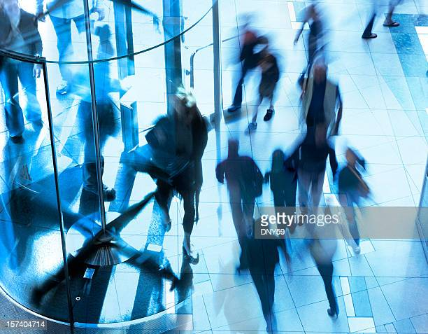 multiple exposure of pedestrians on the move - revolve stock photos and pictures