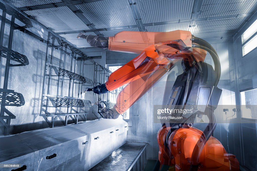 Multiple exposure of robot spray painting automotive parts in spray paint factory, close up : Stock Photo