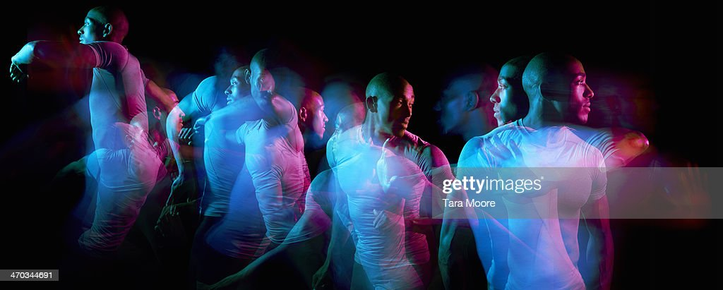 multiple exposure of sports man moving : Stock Photo