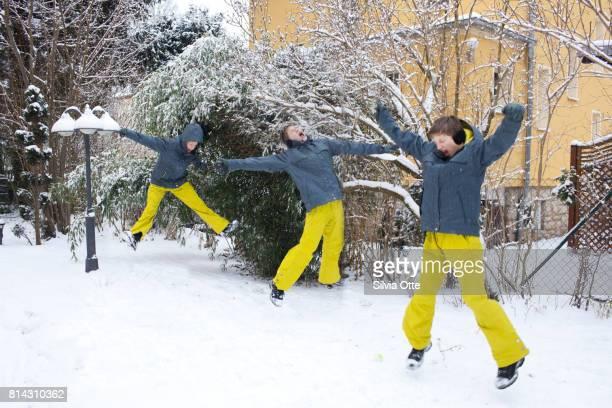 Multiple exposure of teenage boy jumping in snow