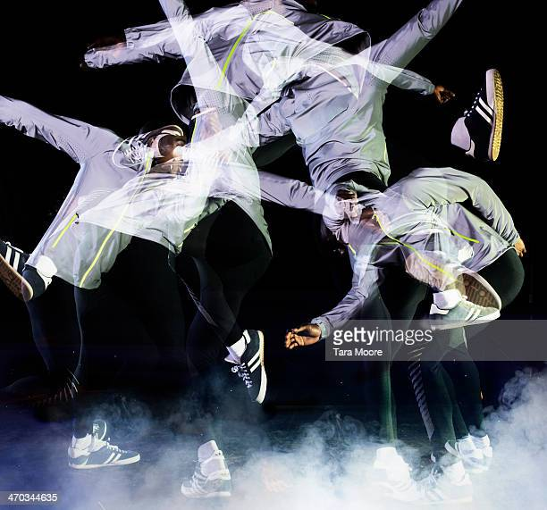multiple exposure of urban man jumping - performance stock pictures, royalty-free photos & images