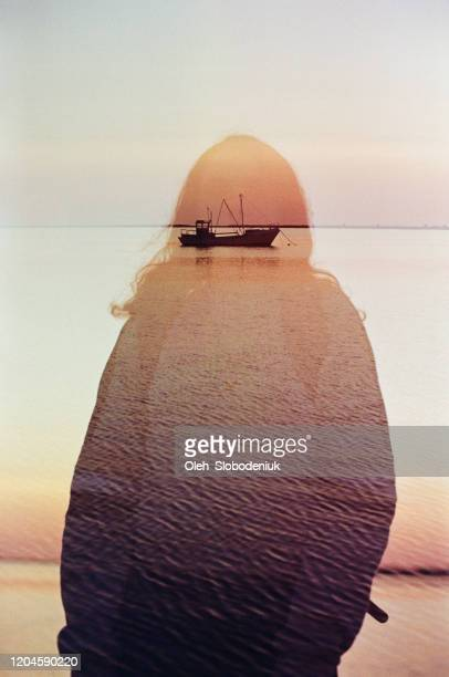 multiple exposure of woman and boat on the sea - calm before the storm stock pictures, royalty-free photos & images