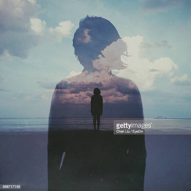 multiple exposure of woman on beach against cloudy sky - mehrfachbelichtung stock-fotos und bilder