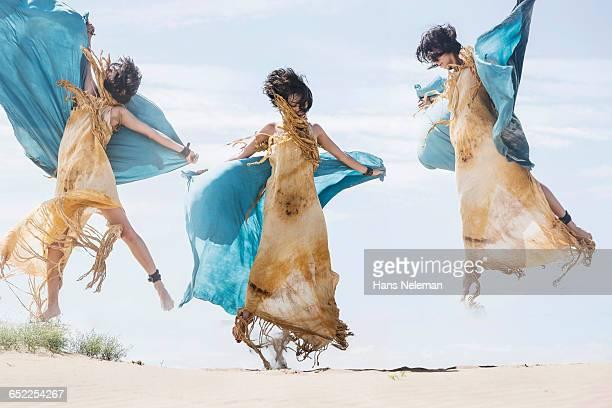 Multiple exposure of woman performing dance