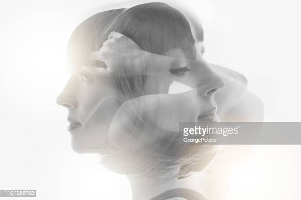 multiple exposure of woman recovering from mental illness - schizophrenia stock pictures, royalty-free photos & images