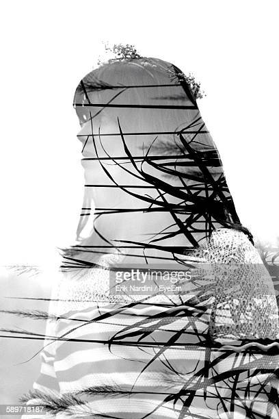Multiple Exposure Of Young Woman And Plants Against Clear Sky