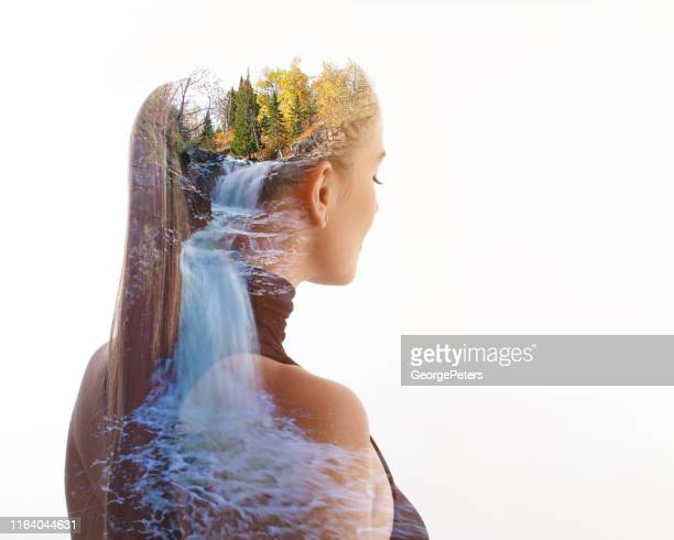 multiple exposure of young woman and waterfall - mindfulness stock pictures, royalty-free photos & images
