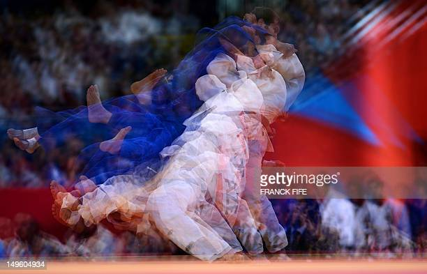 A multiple exposure picture shows Azerbaijan's Elkhan Mammadov competing with Germany's Christophe Lambert during their men's 90kg judo contest match...