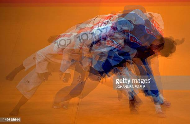 A multiple exposure picture shows Colombia's Yuri Alvear competing with Slovenia's Rasa Sraka during their women's 70kg judo contest repechage match...