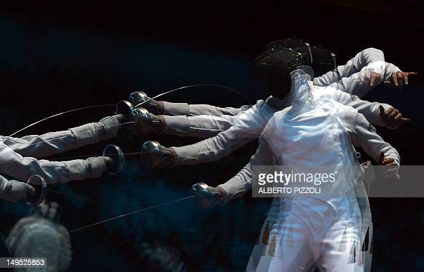 A multiple exposure picture shows Italy's Bianca Del Carretto fencing against Germany's Britta Heidemann uring their Women's Epee fencing bout as...