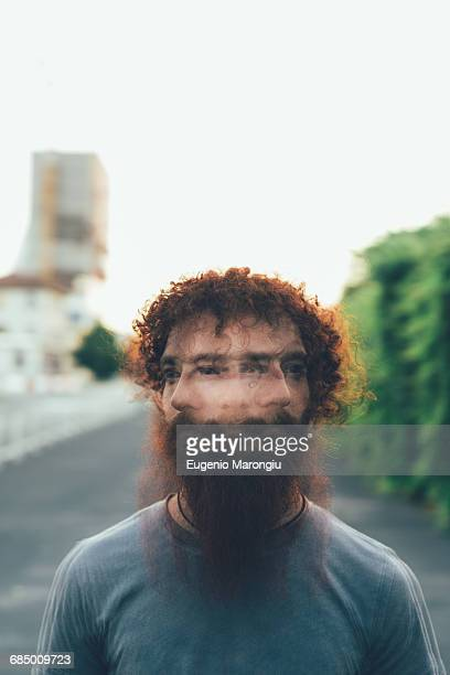Multiple exposure portrait of young male hipster shaking head