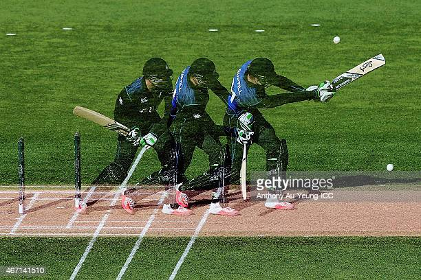 A multiple exposure sequence of Martin Guptill of New Zealand bats during the 2015 ICC Cricket World Cup match between New Zealand and the West...