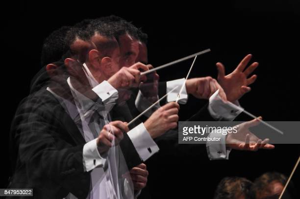 A multiple exposure shows English conductor Ben Glassberg leading the Lyon national orchestra during the 55th edition of the orchestra conductors...