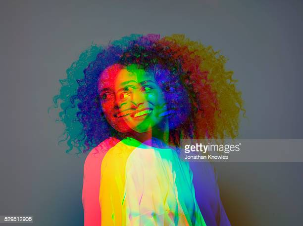 multiple exposure,dark skinned female smiling - curly stock pictures, royalty-free photos & images