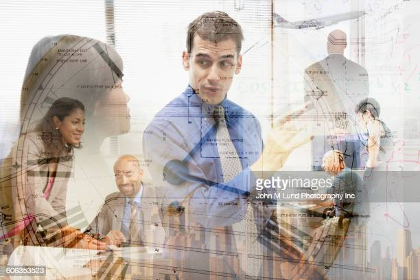 Multiple exposures of business people and clock