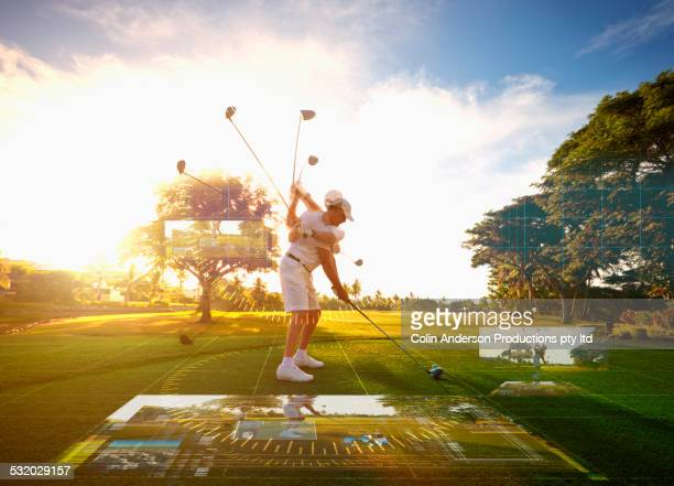 multiple exposures of caucasian golfer hitting ball on course surrounded by holograms - golf swing stock pictures, royalty-free photos & images