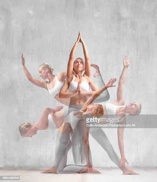 multiple exposures of caucasian woman practicing yoga in studio - mehrfachbelichtung stock-fotos und bilder