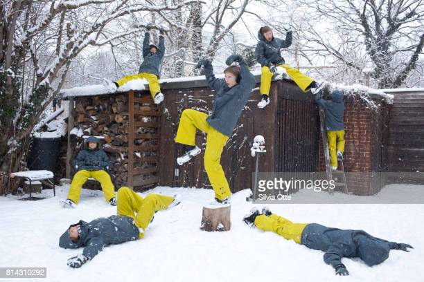 Multiple Exposures of same boy having fun in snow