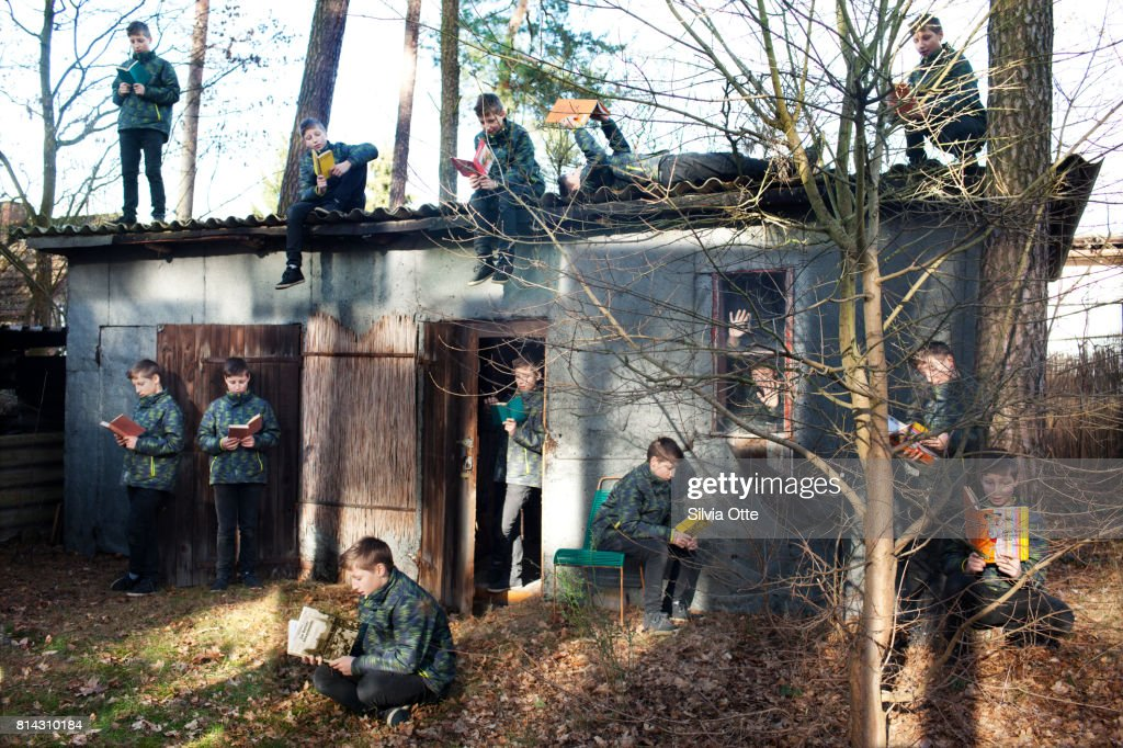Multiple Exposures of Teenager in reading different books in forest : Stock-Foto