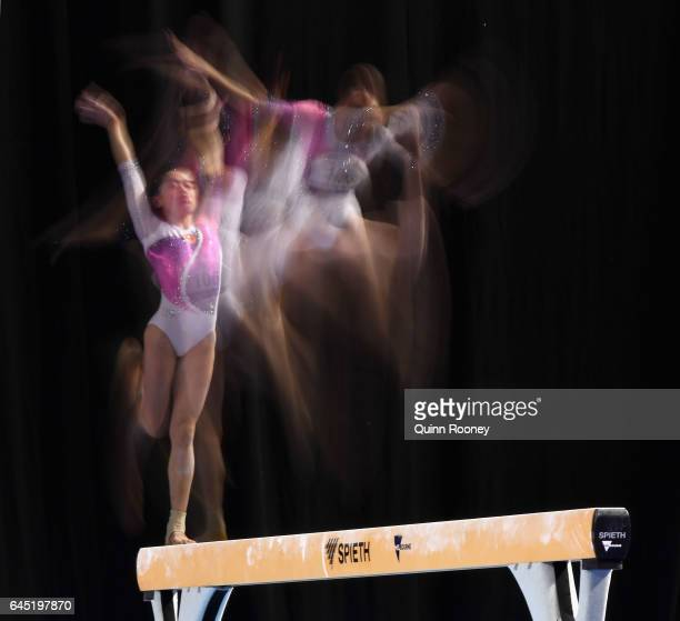 Multiple exposures were combined in camera to produce this image.) Tingting Liu of China performs on the Beam during the World Cup Gymnastics at...